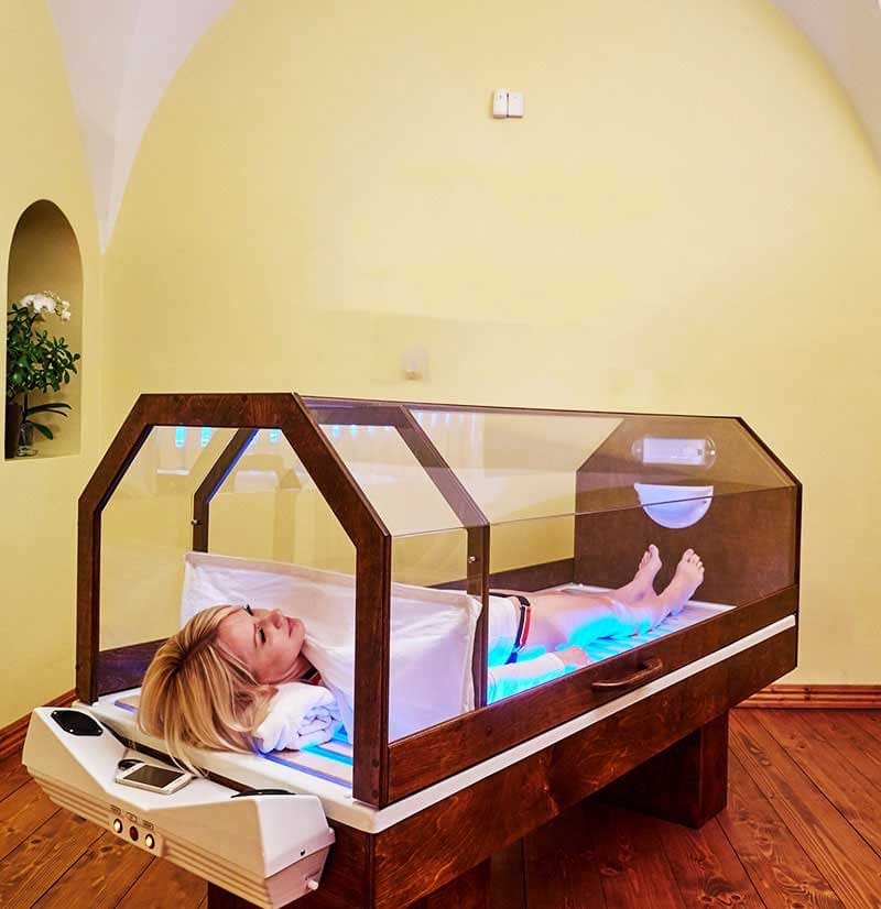 woman lying in salt therapy bed